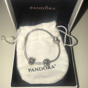 An authentic Pandora bracelet with two charms